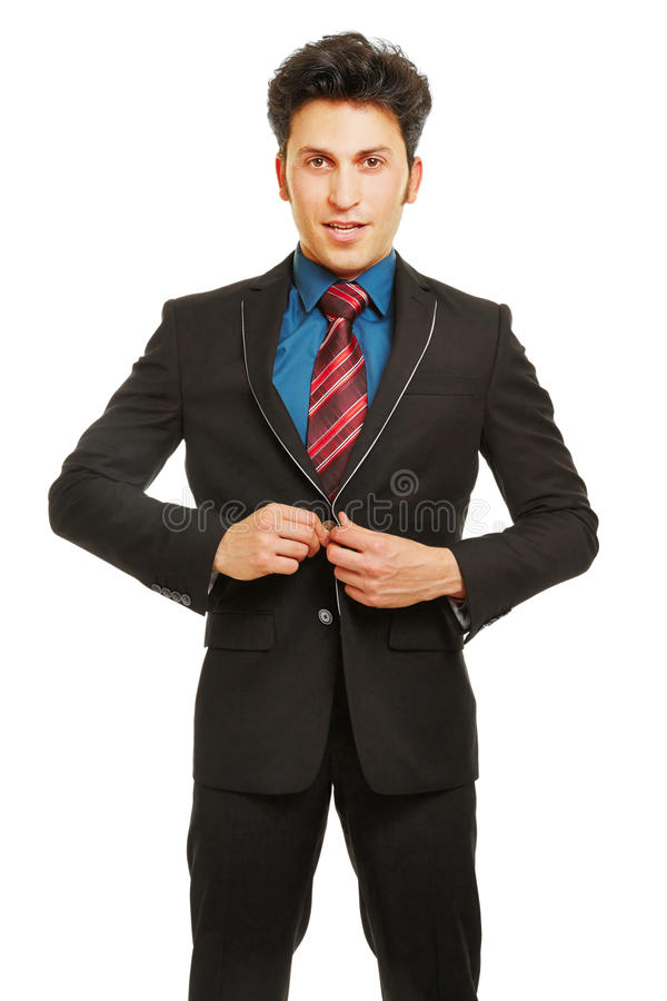Bouton fermant d'homme d'affaires de costume image stock