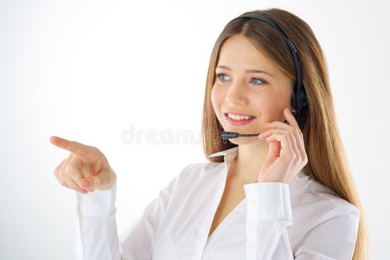 Bouton imaginaire émouvant d'opérateur d'appel de femme images libres de droits