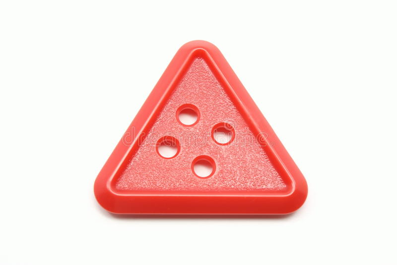Bouton rouge de triangle photographie stock