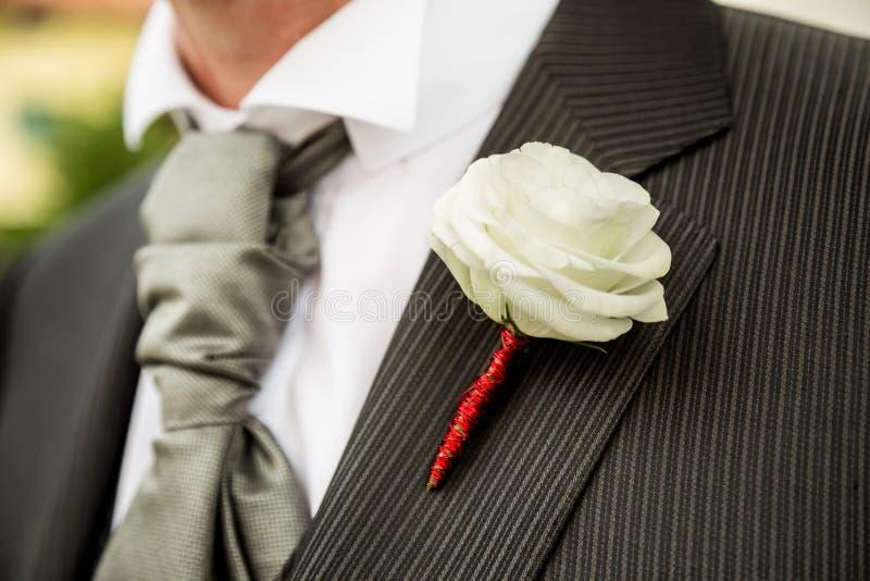 Boutonniere in tuxedo stock photo