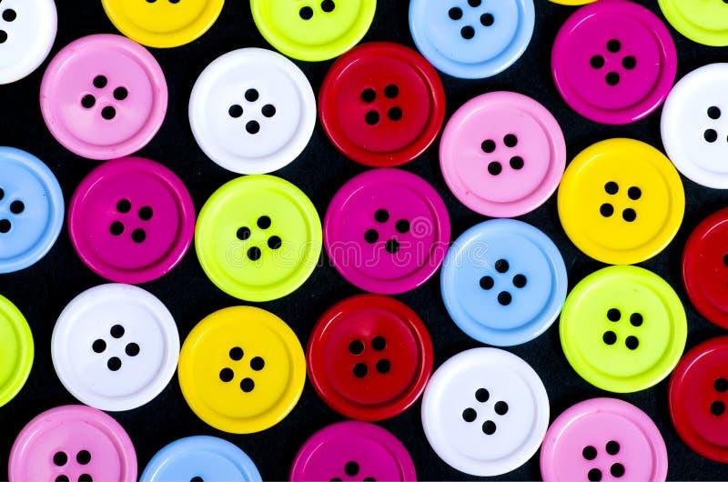 Boutons de couture, boutons en plastique, boutons colorés fond, Bu photographie stock