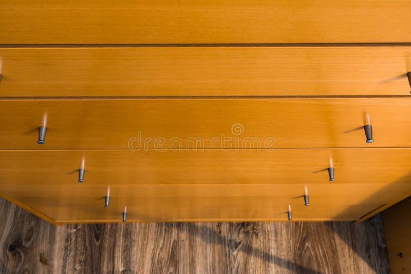 Boutons de fond en bois de modèle de texture de tiroir de raboteuse photographie stock libre de droits