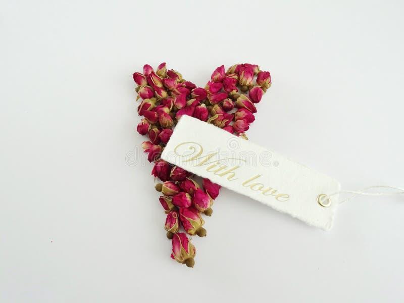 Boutons de rose avec l'étiquette images libres de droits