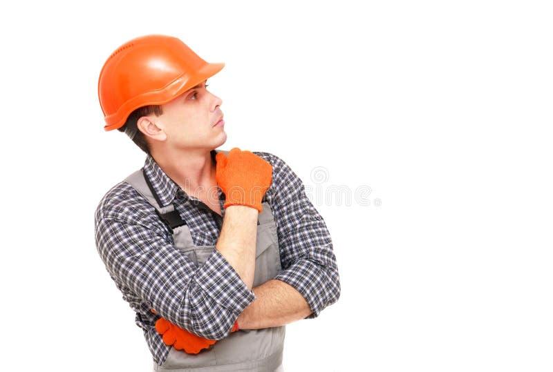 Bouwer in de de bouwoverall en helm stock foto's