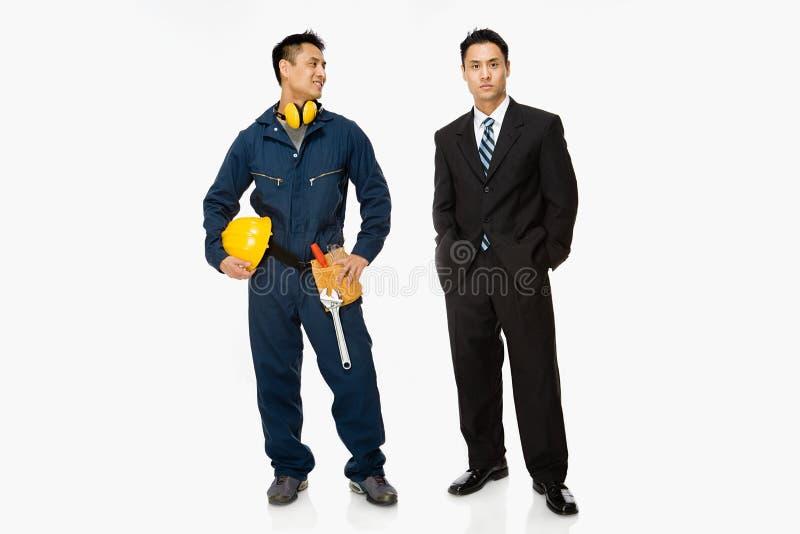 Bouwer en zakenman royalty-vrije stock afbeelding