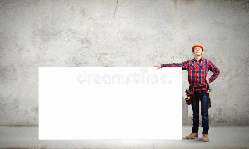 Bouwer met banner stock afbeeldingen