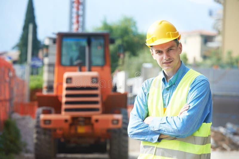 Bouwersingenieur bij bouwwerf stock foto's