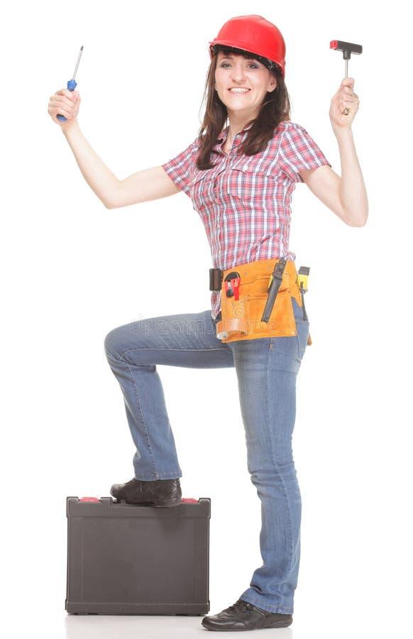 Bouwersvrouw met hulpmiddelen op witte achtergrond royalty-vrije stock foto