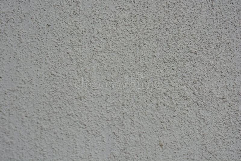 Bouwmaterialen, wit pleister, bekleding van de bouw van muren met een patroon en een structuur, witte heldere achtergrond royalty-vrije stock fotografie