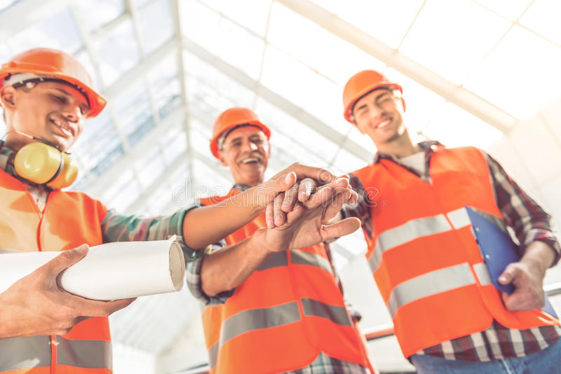 Bouwnijverheidsarbeiders stock foto