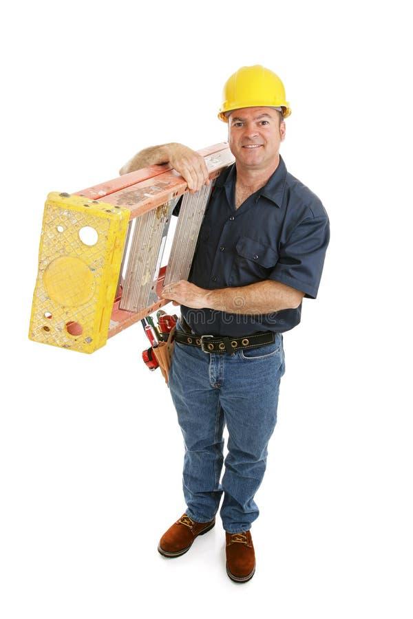 Bouwvakker en Ladder stock foto's