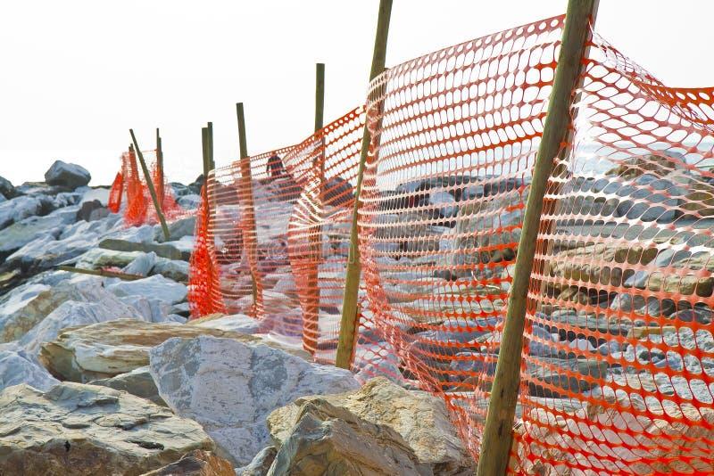 Bouwwerf met veiligheids oranje net royalty-vrije stock foto