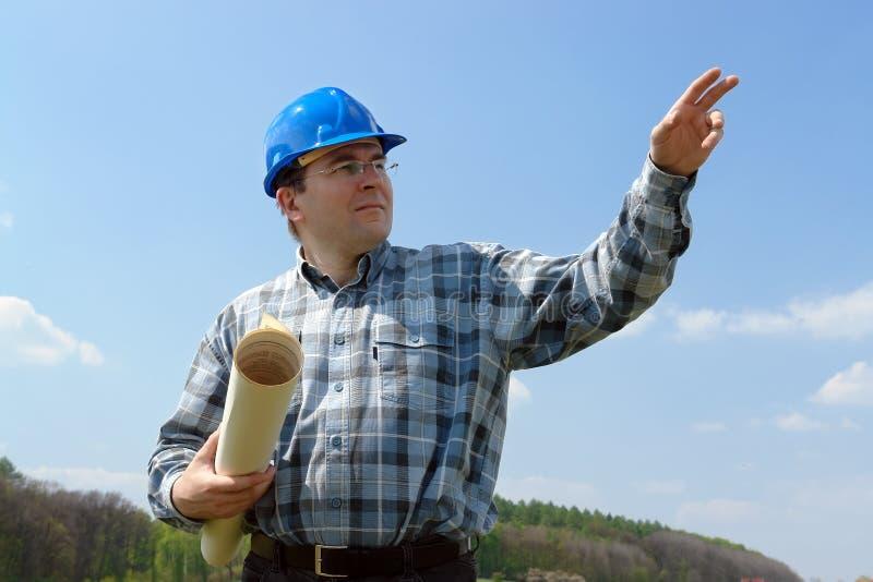 Bouwwerfmanager met de bouw van plannen stock foto