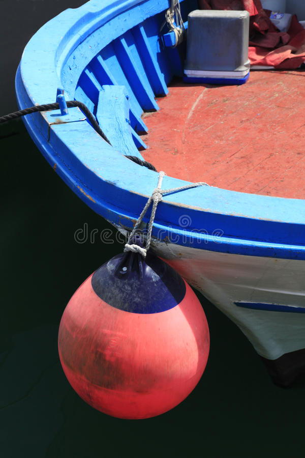 Bouy Hanging from Old European Fishing Boat royalty free stock photography