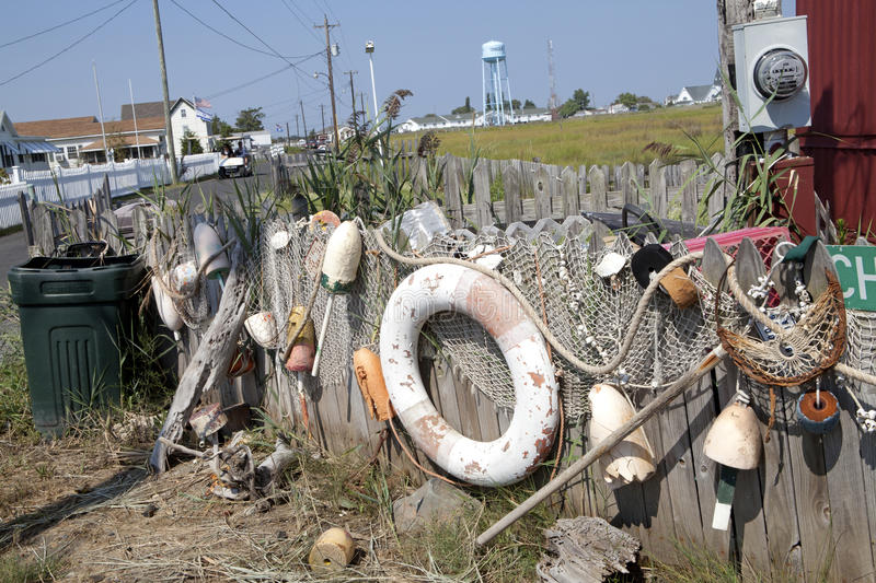 Bouys and a life ring. Old bouys, fishing nets and a life ring decorate a picket fence, Chesapeake stock images