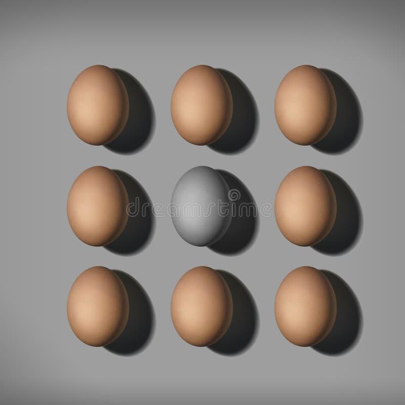 Bovenaanzicht van bruine eieren en grijze eieren in het midden Kleurloos ei tussen bruine gekleurde eieren stock fotografie