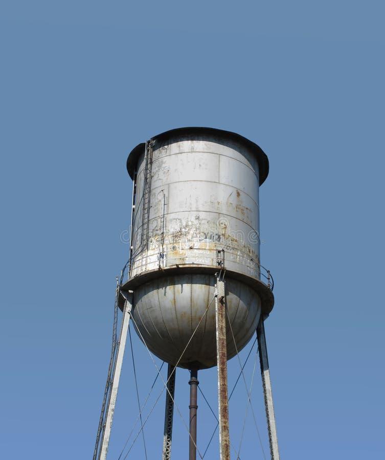 Bovenkant van een ouderwetse geïsoleerdet watertoren stock afbeeldingen
