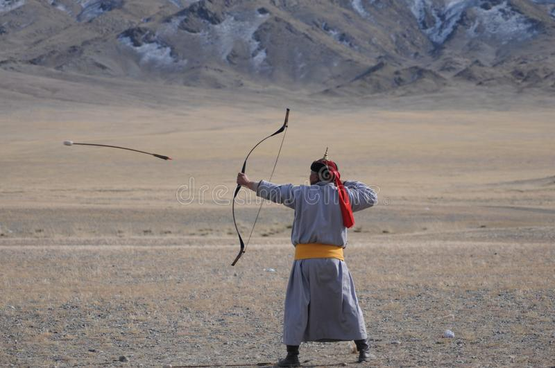 Bow and arrow contest during the golden eagle festival in mongolia stock images