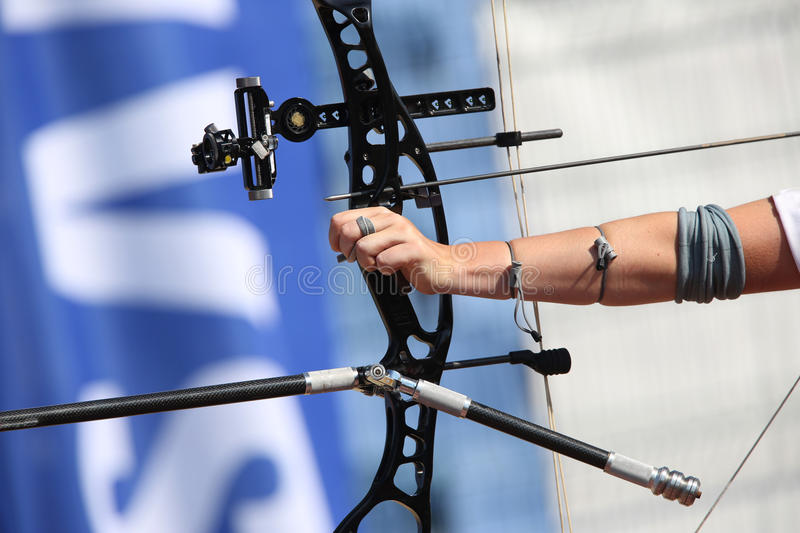 Bow and arrow in the hands of an archer royalty free stock photo