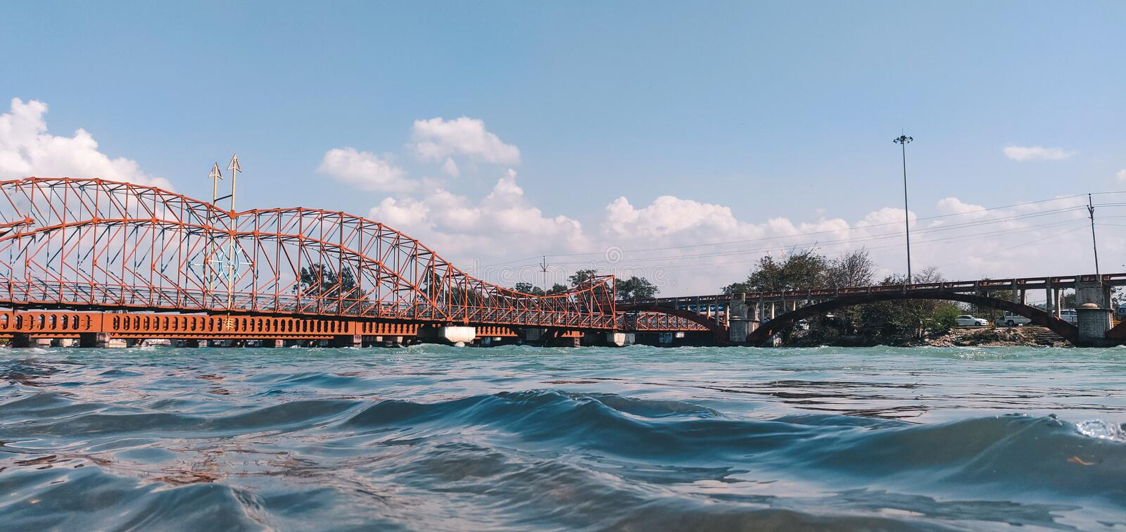 A bow and arrow shaped bridge over The Holy river Ganga at Haridwar. Bow and arrow design is derived from a weapon used in the. Ancient Hindu history royalty free stock image