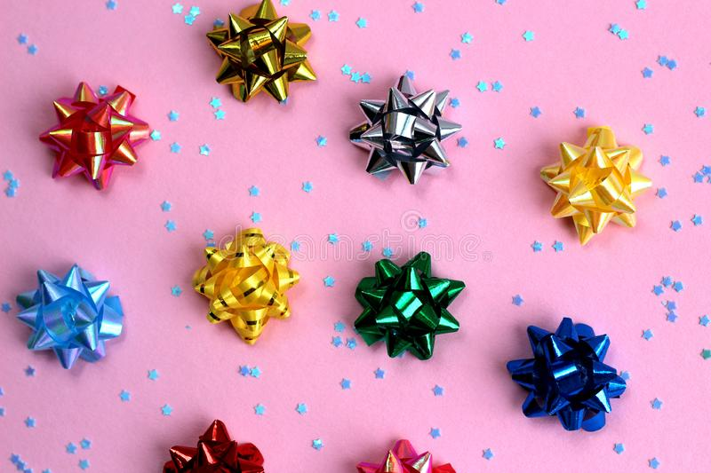 Texture of a lot of festive bows in the form of a star on a pink background. Bow, background picture, banner, birthday, celebration, chic, christmas, decor royalty free stock photos