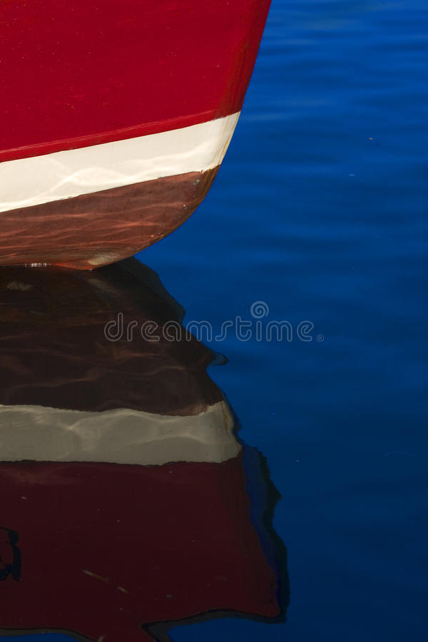 Bow of the boat. With reflection in water stock image