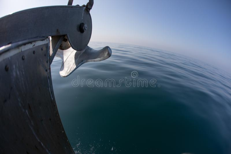 A bow of a boat on a calm ocean surface on a clear day stock photography