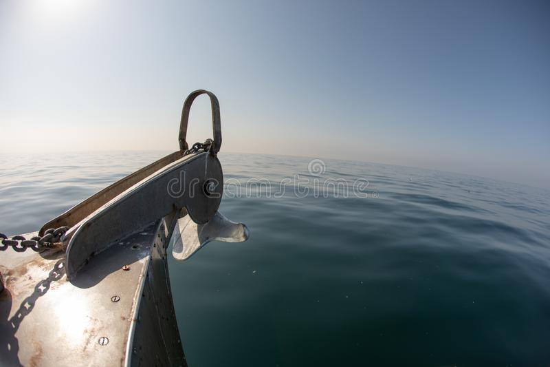 A bow of a boat on a calm ocean surface on a clear day royalty free stock photography