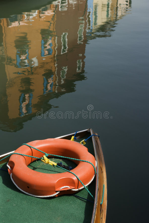 Bow of boat with life preserver. stock photos