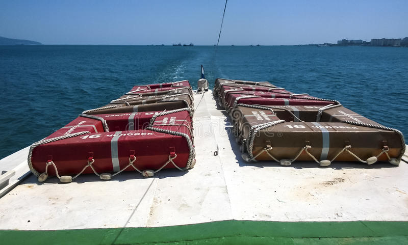 The bow of the boat with survival squares for 16 people. Sea port. Novorossiysk, Russia - August 11, 2016: The bow of the boat with survival squares for 16 royalty free stock photo