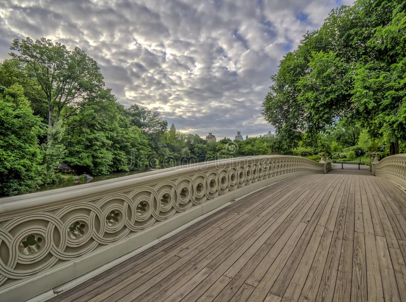 Bow bridge Central Park. The Bow Bridge is a cast iron bridge located in Central Park, New York City, crossing over The Lake stock photography