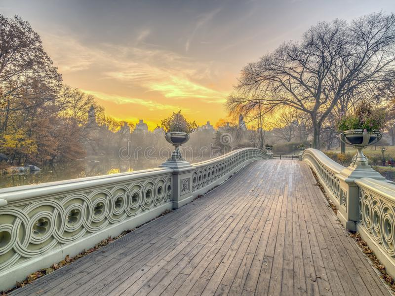 Bow bridge Central Park. The Bow Bridge is a cast iron bridge located in Central Park, New York City, crossing over The Lake stock image