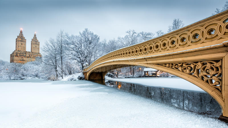 Bow Bridge in Central Park, NYC. At dawn, after a snow storm royalty free stock image
