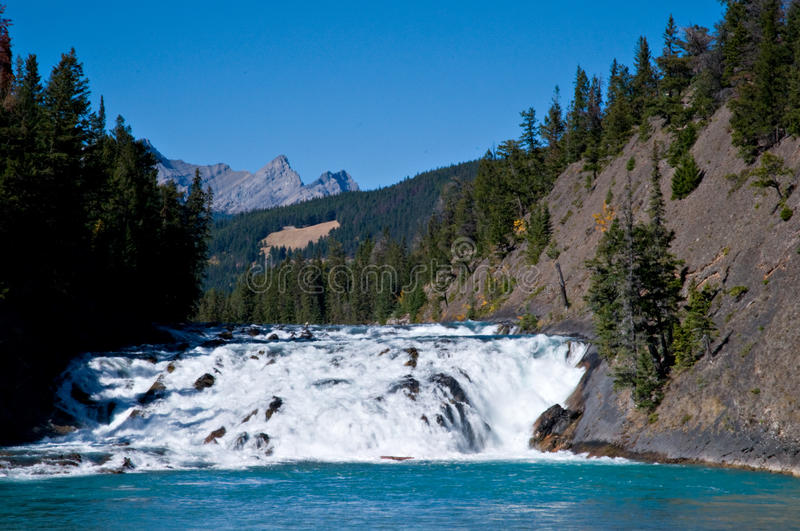 Bow Falls. In Banff National Park, Alberta Canada with deep blue sky and clear wter stock photography