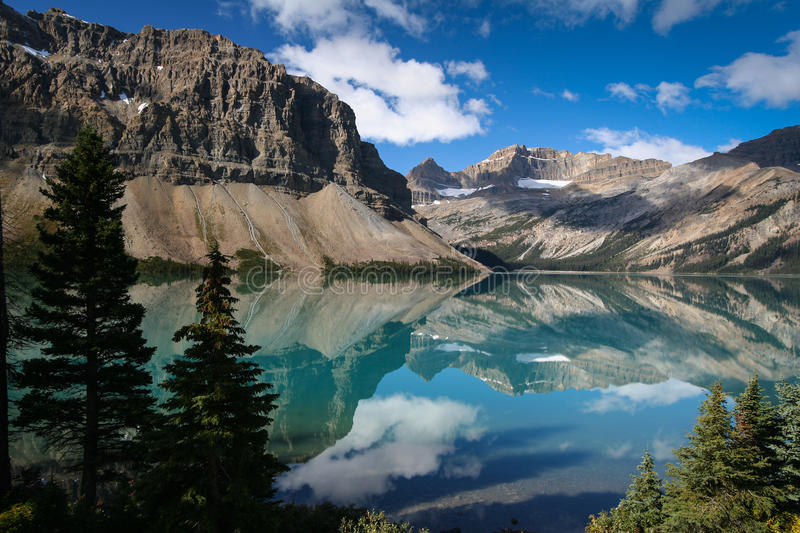 Bow Lake at the Banff National Park in Canada. The wonderful Bow Lake at the Banff National Park in Canada with great reflections in the water royalty free stock photos