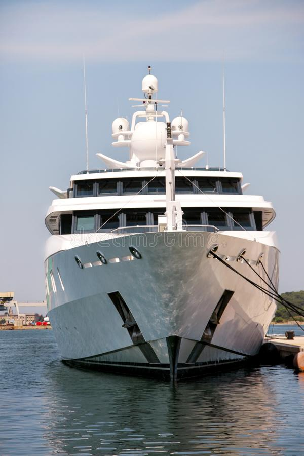Anchored At Potato Harbor: Bow Of Large Modern White Yacht Anchored In The Port Stock