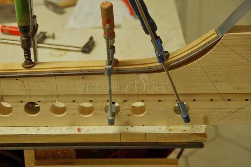 Close up of making recurved bow in workshop. bow-maker stock photos