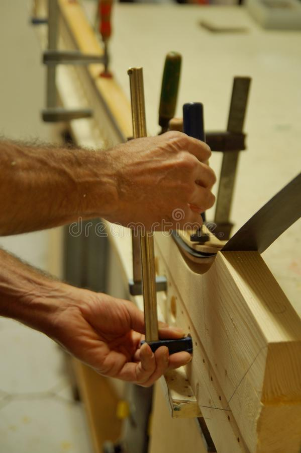 Close up of making recurved bow in workshop. male bow-maker stock photography
