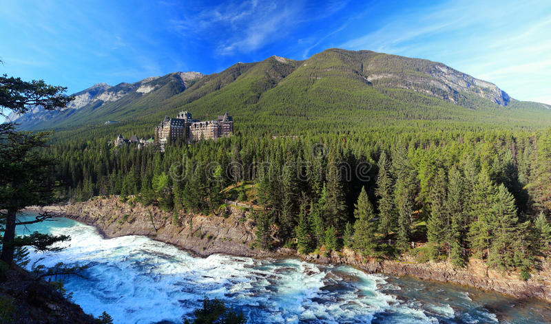 Early Morning Light on Bow River Falls and Banff Springs Hotel in the Rocky Mountains, Banff National Park, Alberta, Canada royalty free stock photos