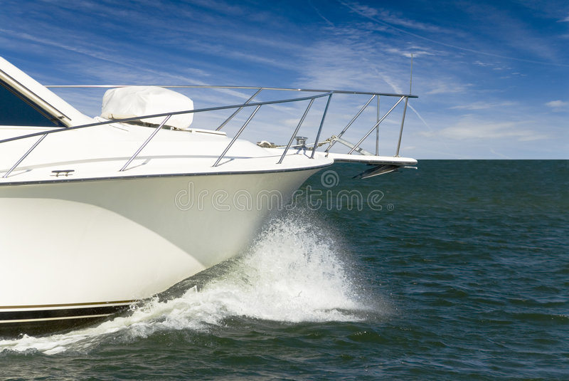 Bow Spray. A power boat charges through the ocean throwing spray from the bow stock images
