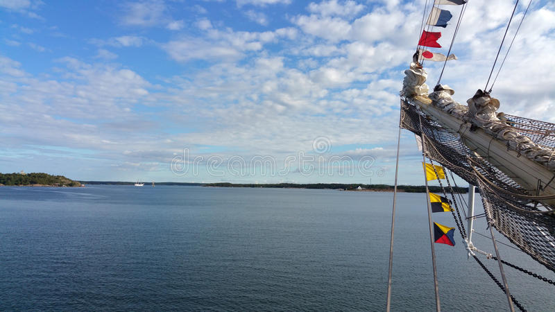 The bow of tall ship on the background of the sky with clouds. Tall Ship Races. stock photo