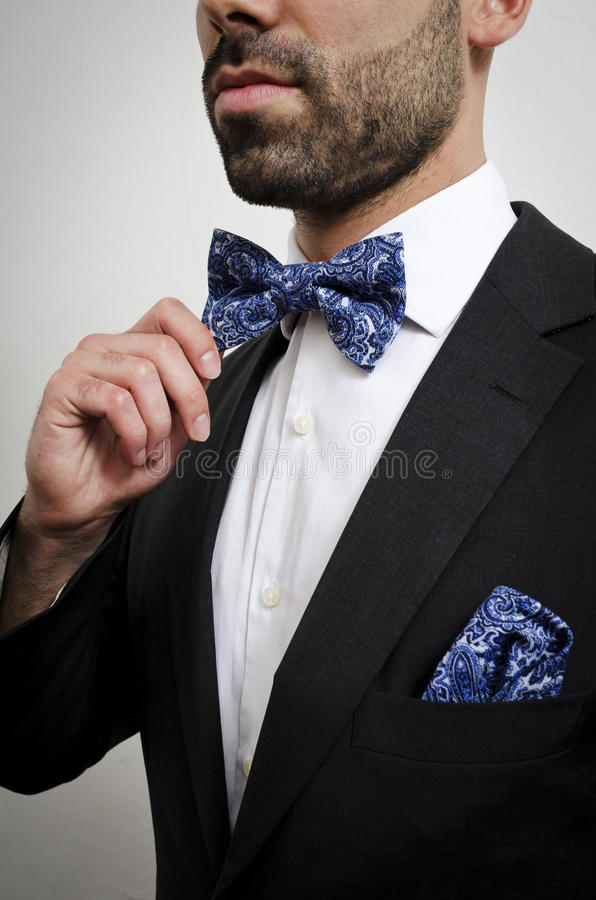 Bow tie. Businessman in a suit with pocket square and bow tie stock image