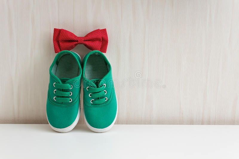 Download Bow Tie And Green Shoes On Background Wall With Wallpaper Stock Image