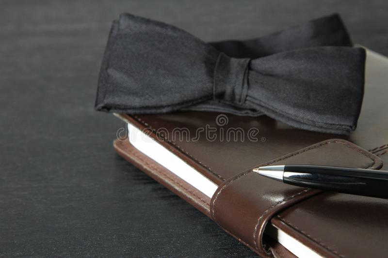 Bow tie, notebook and pen royalty free stock photos