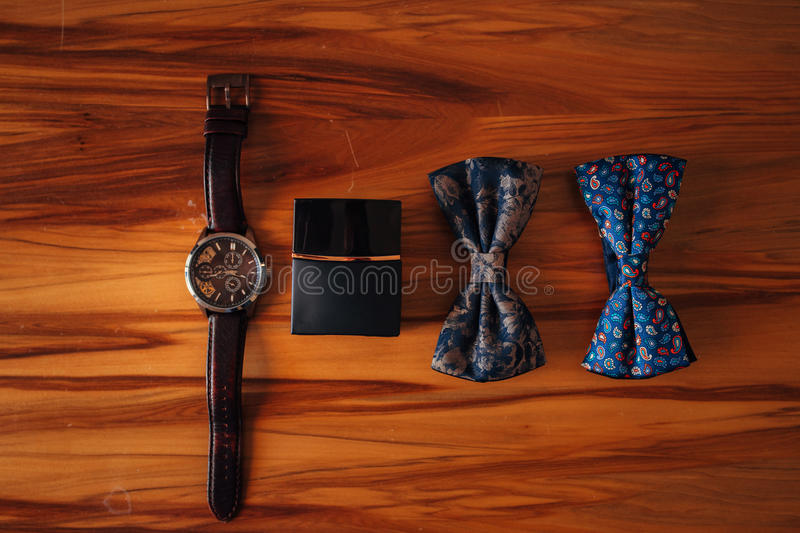 Bow tie, watch and cologne stock photo