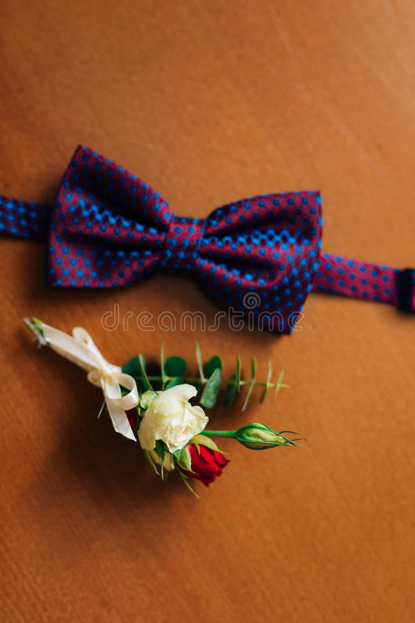 Bow tie on a wooden background royalty free stock photography