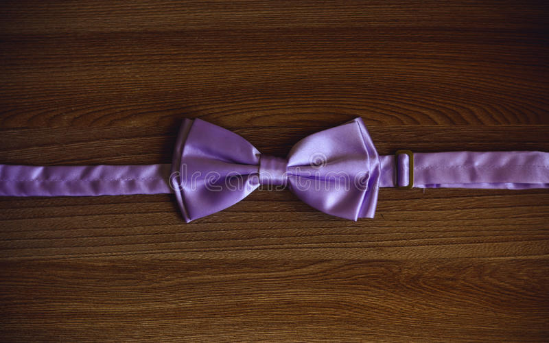 Bow-tie on wooden background stock photography