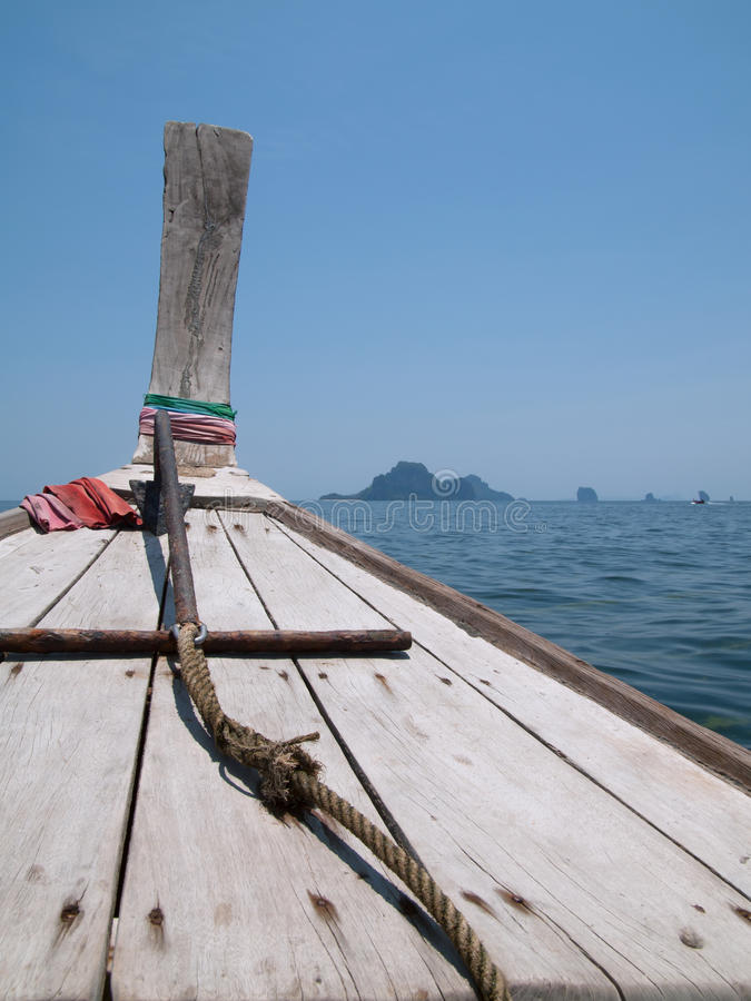Bow of wooden boat at the Andaman Sea, Thailand. Bow of traditional wooden boat heading out towards the Andaman Sea off the coast of Krabi, Thailand stock photos