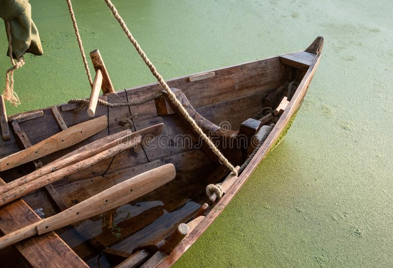 Bow of a wooden boat. A fragment of a craftmade wooden boat, assembled based on the sailing-rowing ships of the Viking Age. part of a small drakkar royalty free stock images