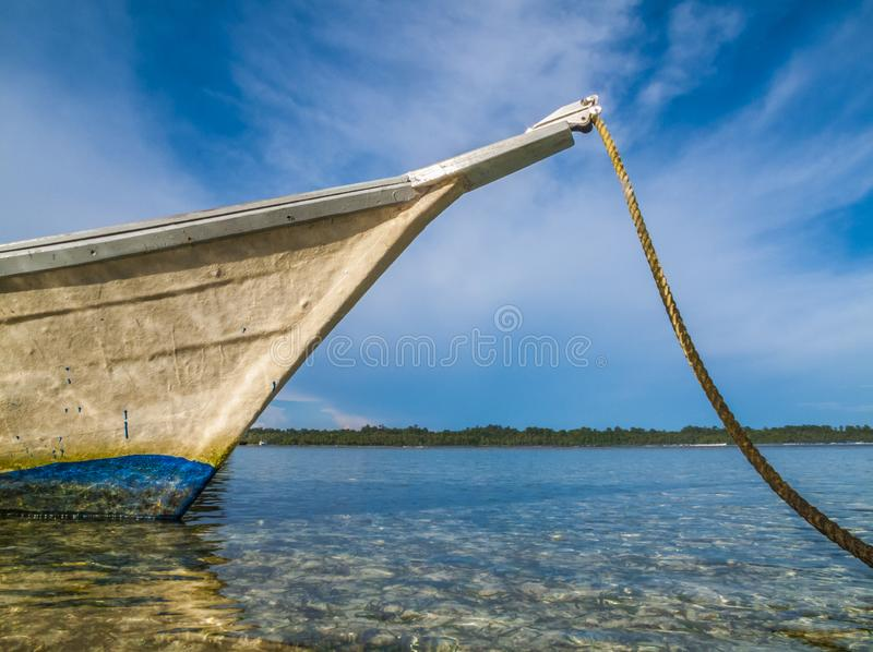 Bow of wooden boat pointing out to sea. Against sunny sky stock images
